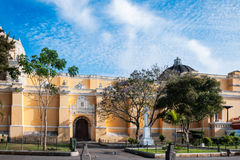 Fair weather in Antigua highlighting the beauty of La Merced Church. View of the side elevation of La Merced Church close to sunset in historic center of Antigua stock image