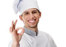Faire des gestes d'ok de cuisinier Photographie stock