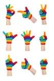Faire des gestes de gants d'arc-en-ciel photographie stock