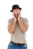 Faire des gestes de sourire de jeune homme Image libre de droits