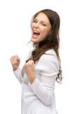 Faire des gestes heureux de poings de femme Photographie stock libre de droits