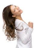 Faire des gestes heureux de poings de fille Photographie stock libre de droits