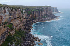 Fairfax Lookout in North Head Manly. Along fairfax walking track in north head of manley new south wales australia overlooking rugged coastline of pacific ocean Royalty Free Stock Image