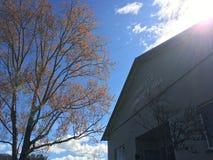 Fairfield community hall in sunlight. Sunlight over rooftop of Fairfield Community Hall against blue skies on sunny day Royalty Free Stock Image