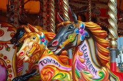 Fairground. A traditional fairground carousel showing names horses freshly painted in vibrant colours Royalty Free Stock Photography