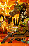 Fairground attraction. A highly decorated wooden horse on a carrousel at a fairground Royalty Free Stock Photo