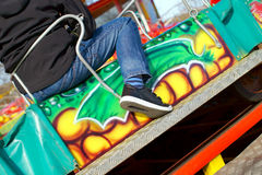 At a fairground attraction. Close-up of a boy sitting on a fairground attraction Royalty Free Stock Photo