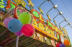 Fairground attraction front plenty of bulbs, leds, balloons and. Colors. Daylight shot royalty free stock photography