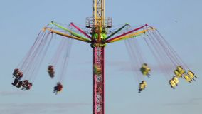 Fairground attraction at sunset (01). Fairground attraction by rotating at sunset with large colorful and motion stock footage