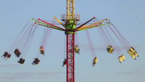 Fairground attraction at sunset. (02). Fairground attraction by rotating at sunset with large colorful and motion.Time Lapse stock video