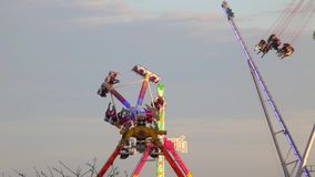 Fairground attractions at sunset (03) stock video footage