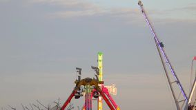 Fairground attractions at sunset. (05) stock footage