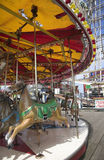 Fairground Carousel. Ride with horses on seaside pier Stock Photo