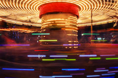 Fairground carousel. Blurred with motion and vintage colors Royalty Free Stock Image