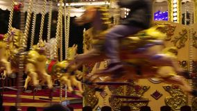 Fairground carousel in Edinburgh during Christmas festive. Close Up footage of fairground carousel in Edinburgh during Christmas festive, Princess Street Gardens stock video