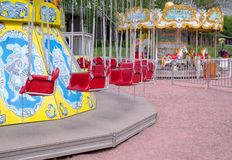 Fairground carousel. Fairground empty carousel for children in the park Stock Photography