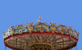 Fairground carousel. Horse on top of fairground carousel against the blue sky Stock Photos
