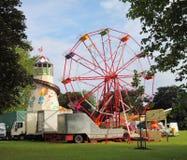 Fairground with Ferris wheel Stock Photo