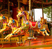Fairground horses. Painted fairground horses on a merry go round on the Southbank, London Stock Photography
