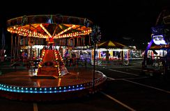 Funky Fairground Ride Scene. Fairground in local town of Winsford. This ride has swings as it spins round with lots of bright lights Stock Images
