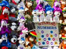 Fairground lucky dip game. With colorful soft toy prizes hanging up on display Royalty Free Stock Photo