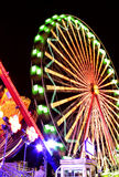 Fairground at Night. With bright lights and motion blur Stock Photography