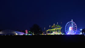 Fairground at night. View looking into the fair at night Royalty Free Stock Photos
