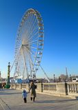 Fairground in Paris. Mother and son walking towards fairground in Paris. Eiffel Tower background with breathtaking blue sky above Stock Images