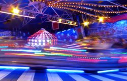 Fairground ride. Speeding fairground 'caterpillar' ride -- image full of excitement and motion blur Royalty Free Stock Photo
