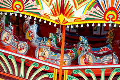 Fairground ride. Colorful motorcycle themed fairground ride Stock Images