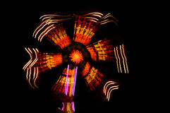 Fairground Ride. A fairground ride at night showing motion light trail/blur Stock Photos