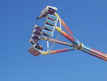 Fairground ride. Colorful Fairground ride against a clear blue sky Royalty Free Stock Photo