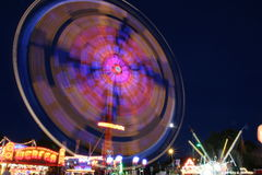 Fairground. Ride lights at night Royalty Free Stock Photo