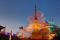 Fairground Ride Motion Blur. Long exposure motion blur of a spinning fairground ride Stock Image