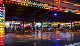 Fairground ride at night. Long exposure of a fairground ride causing light trails Royalty Free Stock Images