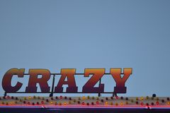 Fairground ride spelling crazy. A picture of a fairground ride crazy sign Royalty Free Stock Photo
