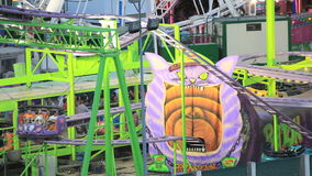 Fairground rides in an amusement park stock video