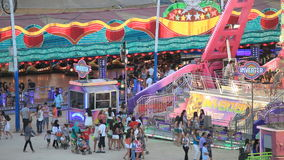 Fairground rides in an amusement park stock footage