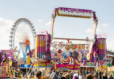 Fairground Rides at the Oktoberfest in Munich. MUNICH, GERMANY - SEPTEMBER 30: Fairground rides at the Oktoberfest in Munich, Germany on September 30, 2015. The Stock Images