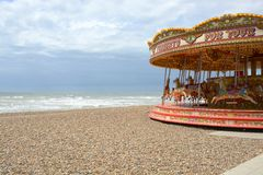 Fairground roundabout on Brighton beach. England Stock Photography