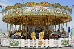 Fairground roundabout on Brighton Pier. England. Old fashioned traditional roundabout on the pier at the seafront of Brighton. East Sussex. England Royalty Free Stock Image
