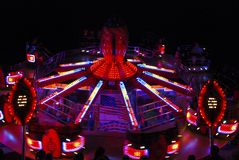 Fairground roundabout at night Stock Photo