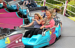 Fairground snake ride. Photo of fairground snake ride passengers having fun at the whitstable funfair show on 17th may 2014.photo ideal for funfairs,fairground Royalty Free Stock Images