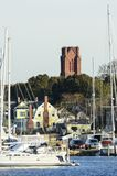 Church tower standing over marina Royalty Free Stock Image