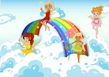 Fairies above the sky near the rainbow. Illustration of the fairies above the sky near the rainbow Royalty Free Stock Image