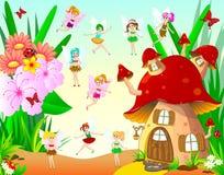 Fairies fly around the mushroom house. Fairies next to the mushroom house and flowers Stock Photography