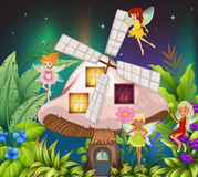 Fairies flying around the mushroom hosue at night Royalty Free Stock Photography