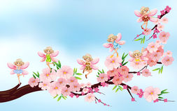 Fairies flying on blossom branch Royalty Free Stock Image