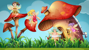Fairies flying in the mushroom garden Royalty Free Stock Photography