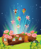 Fairies flying over the log house Stock Photography